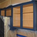 Upper kitchen cabinets painted blue