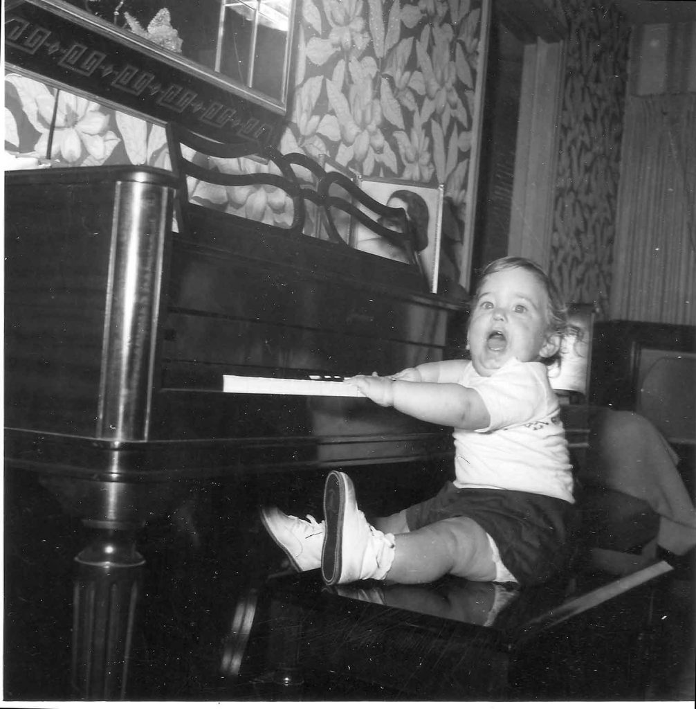 1956. Mom and Dad played piano a little bit from time to time. The first song I learned on that piano was 'My Country Tis of Thee'. Go figure :)