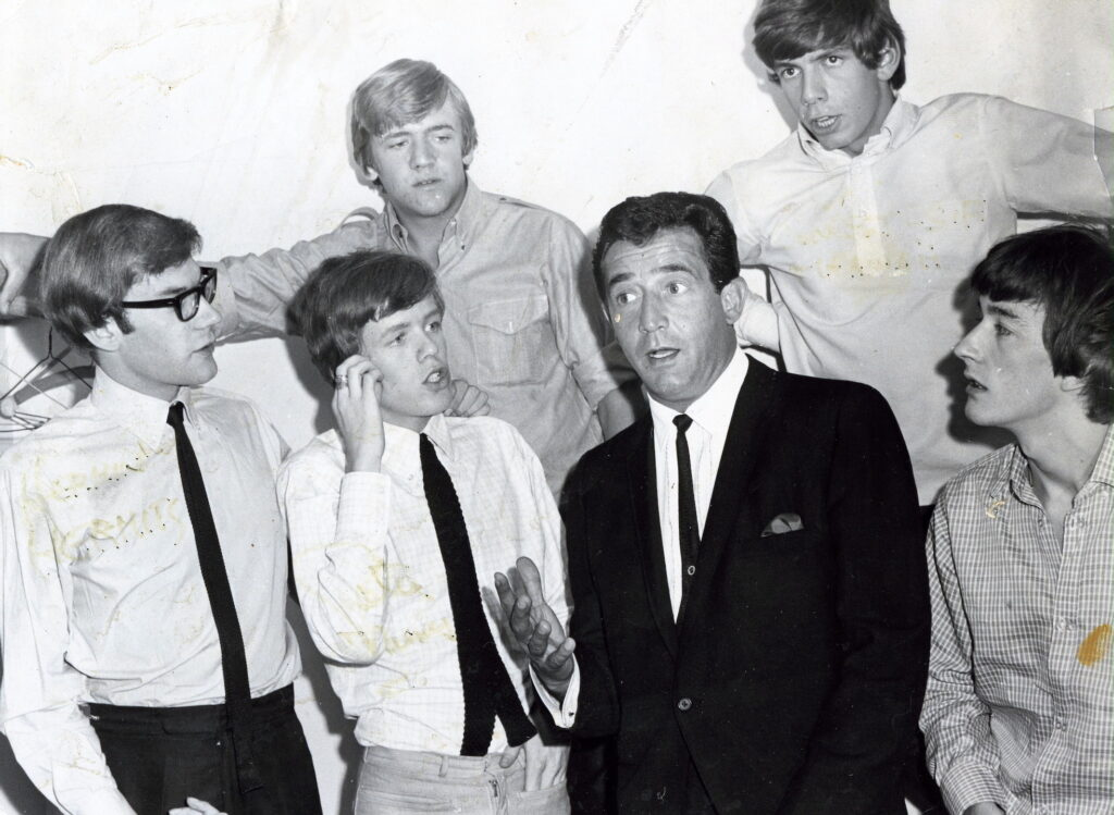 Paul R. Catalana with the Herman's Hermits after their performance at San Jose Civic Auditorium, July 1966. Photograph provided courtesy of Lynn Catalana