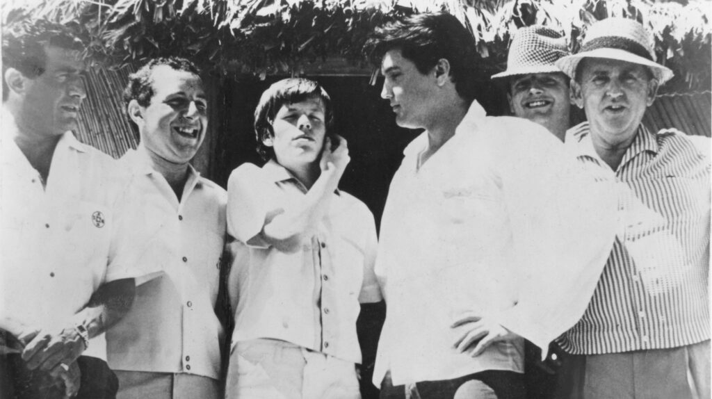 Paul R. Catalana, Herman's road manager, Peter Noone, Elvis, DJ Tom Moffatt & Colonel Parker in Hawaii 1965. Photograph courtesy of Lynn Catalana.