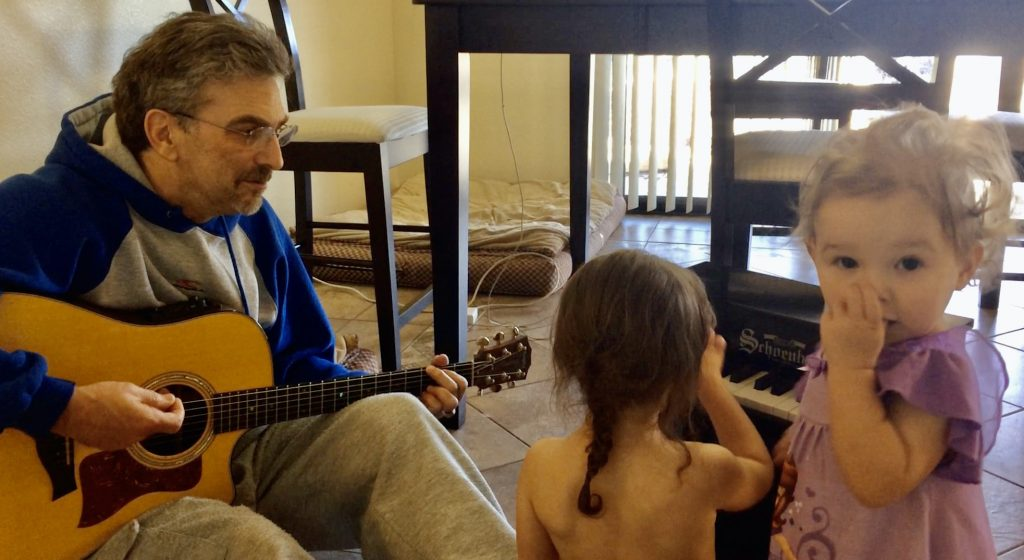 I get a lot of joy playing guitar with my granddaughters Ella and Natasha.