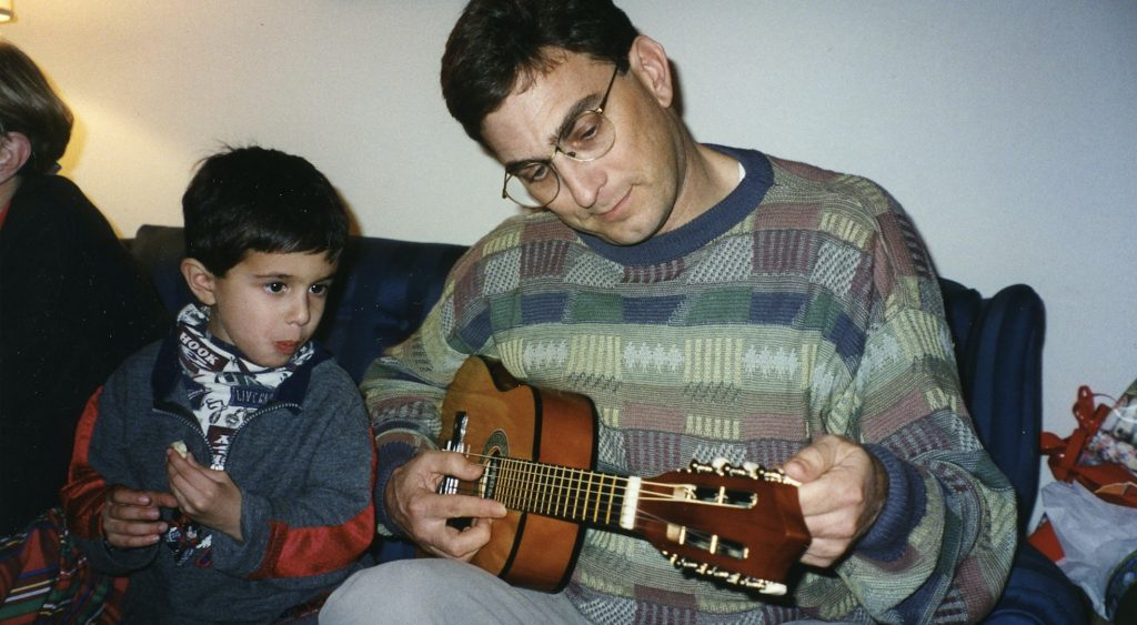 1997: Sharing some guitar playing with nephew Travis.