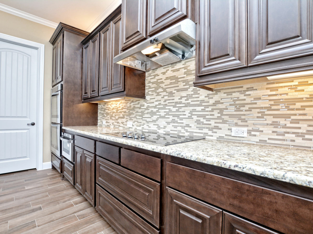 mitered kitchen cabinets with medium wood stain