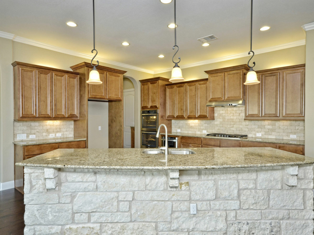 Kitchen cabinets light stain stone island
