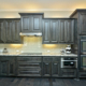 Mitered raised panel kitchen cabinets in dark stain