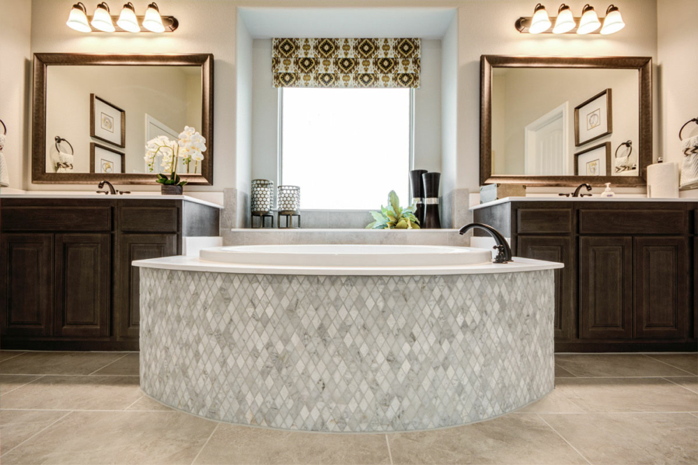 Master bath tub separated vanities