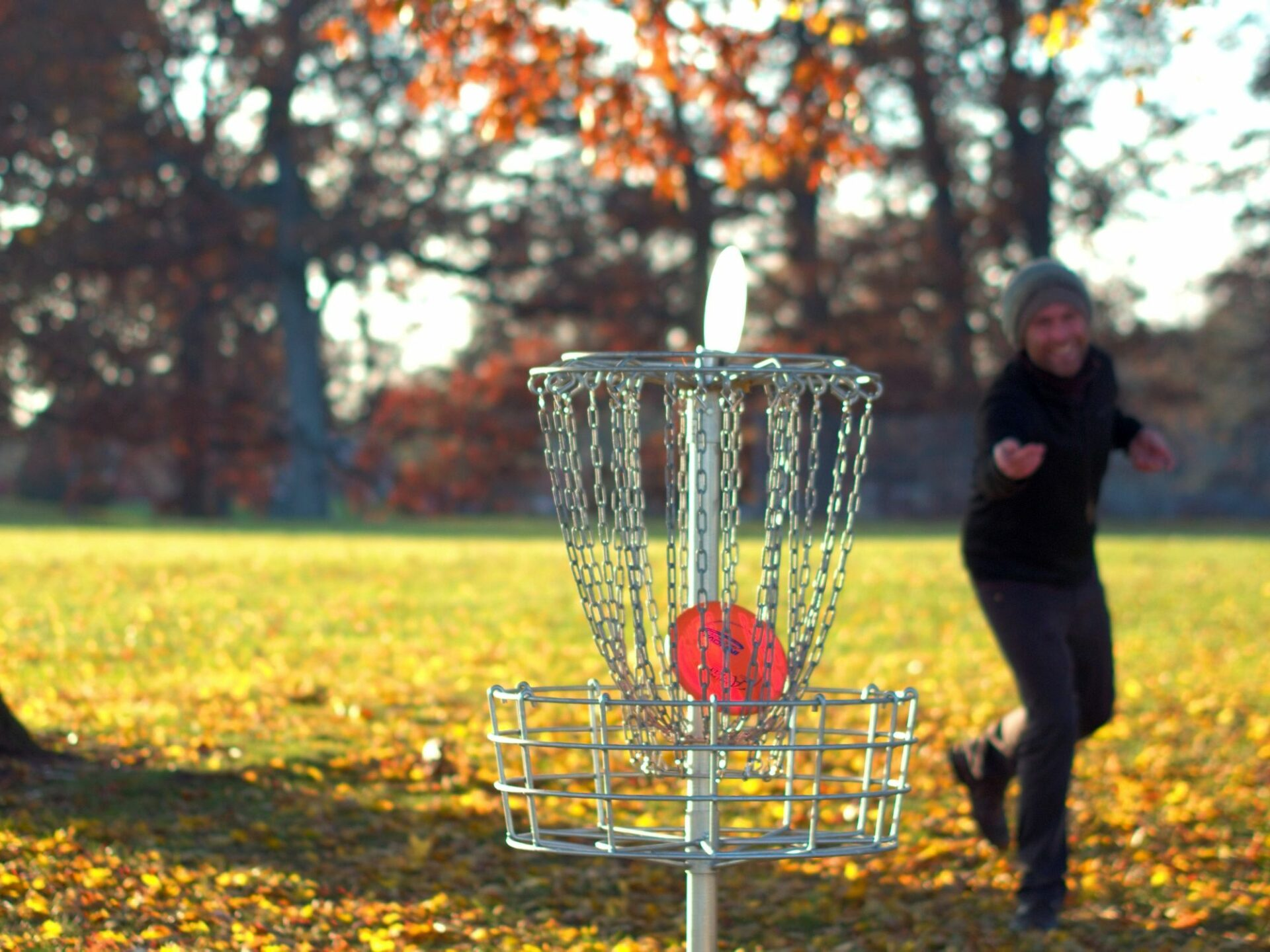 Young Man Playing Frisbee Golf in Fall