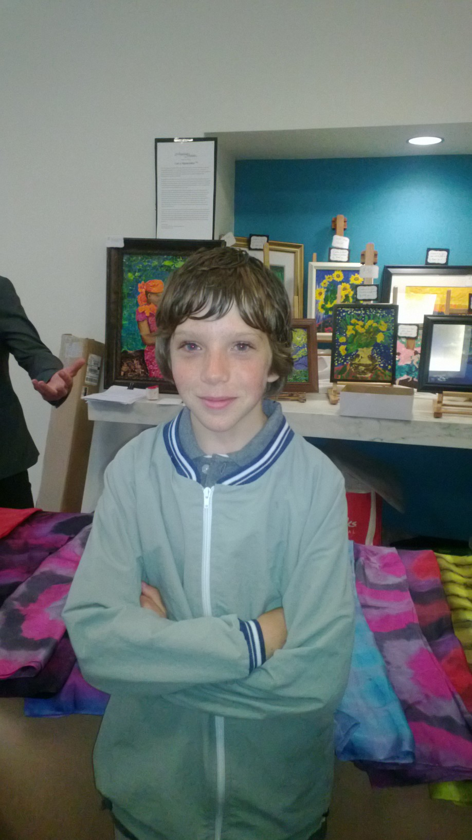 Aidan uses his artistic talents to help children in need by participating in the U.N. exhibit.
