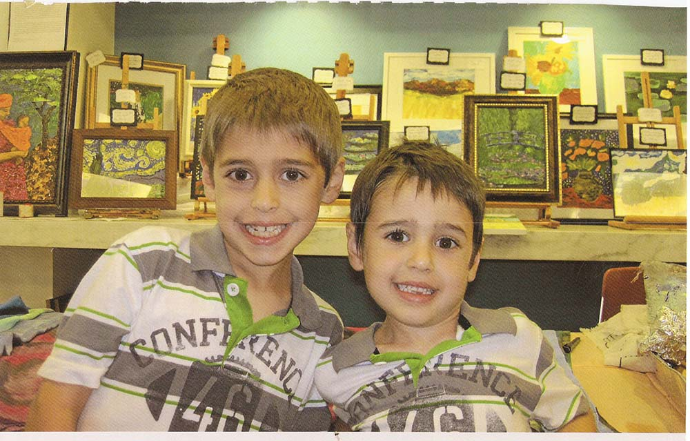 Dante and Gianni display their paintings to raise money for U.N.I.C.E.F. and A.I.M.