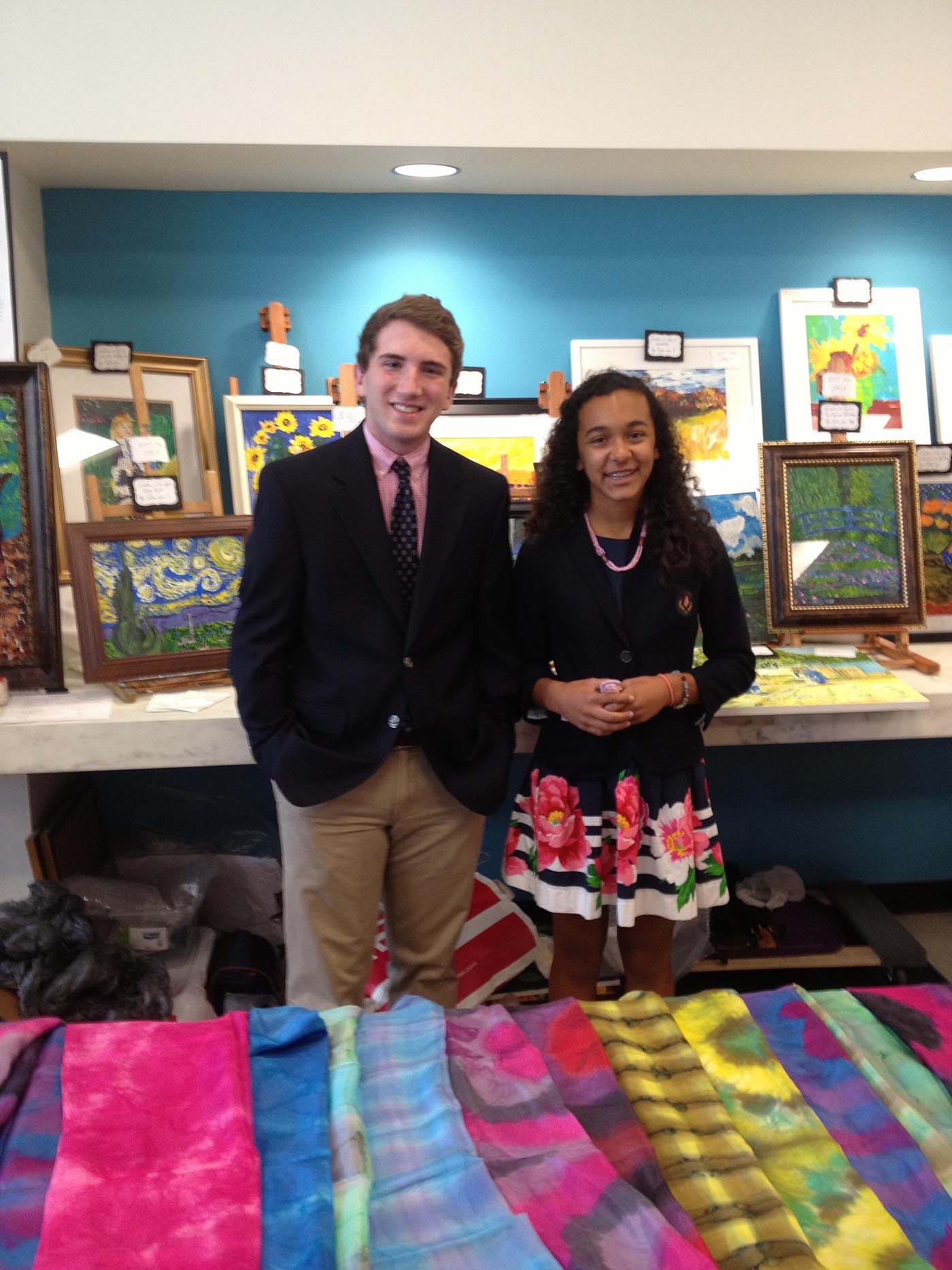 Tyler and Katie display their masterpieces at the United Nations Spouses Bazaar June 13, 2013