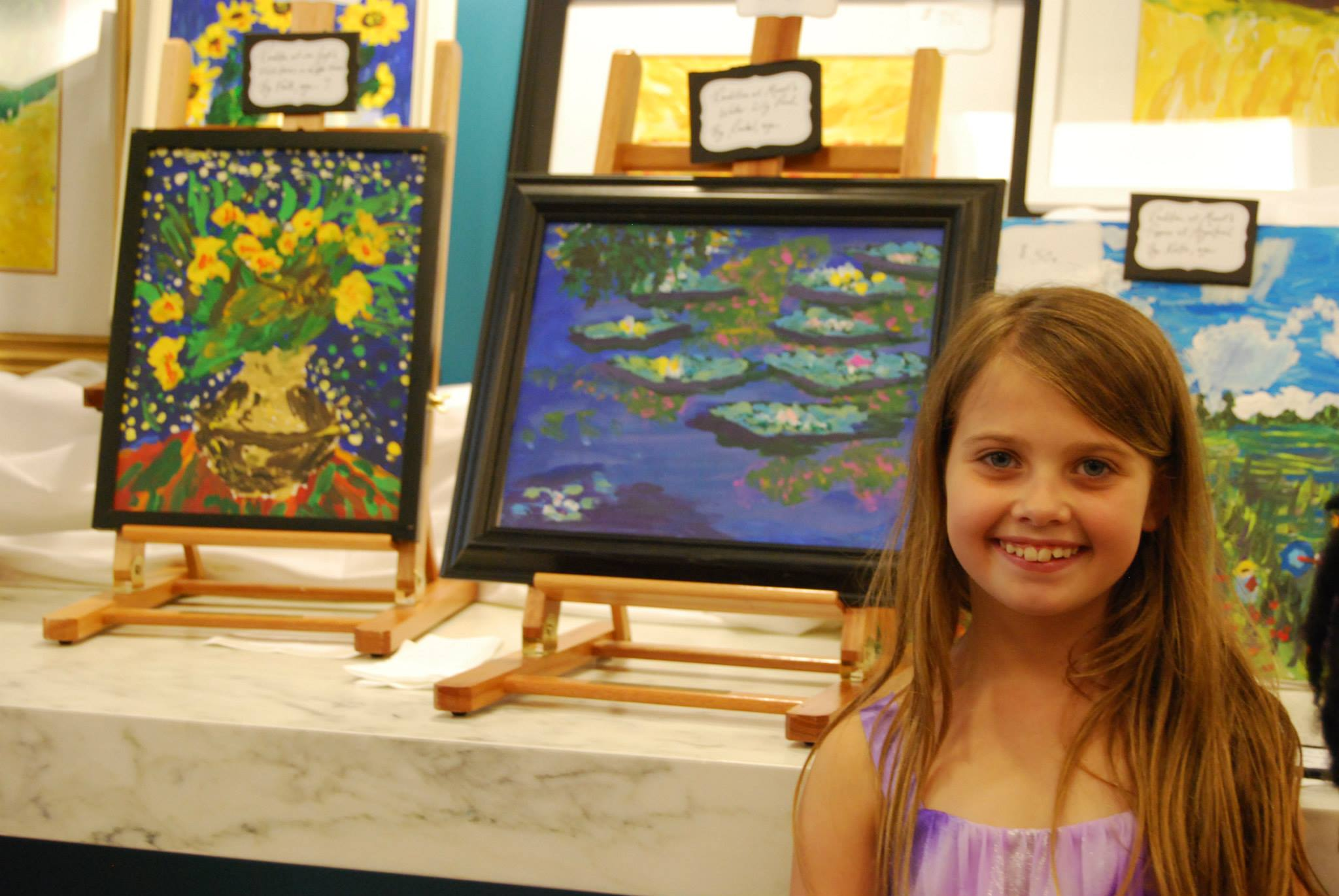Rachel enjoys seeing her masterpieces displayed at the United Nations building!  She felt honored to help other children