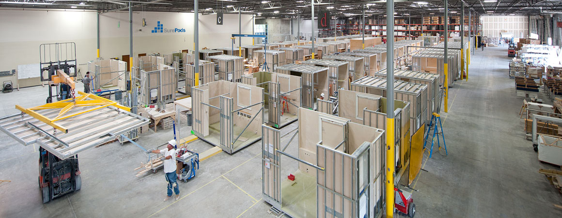 factory buily bathrooms on an assembly line as they are manufactured