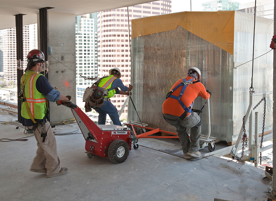 bathroom pod being pulled into a tall building