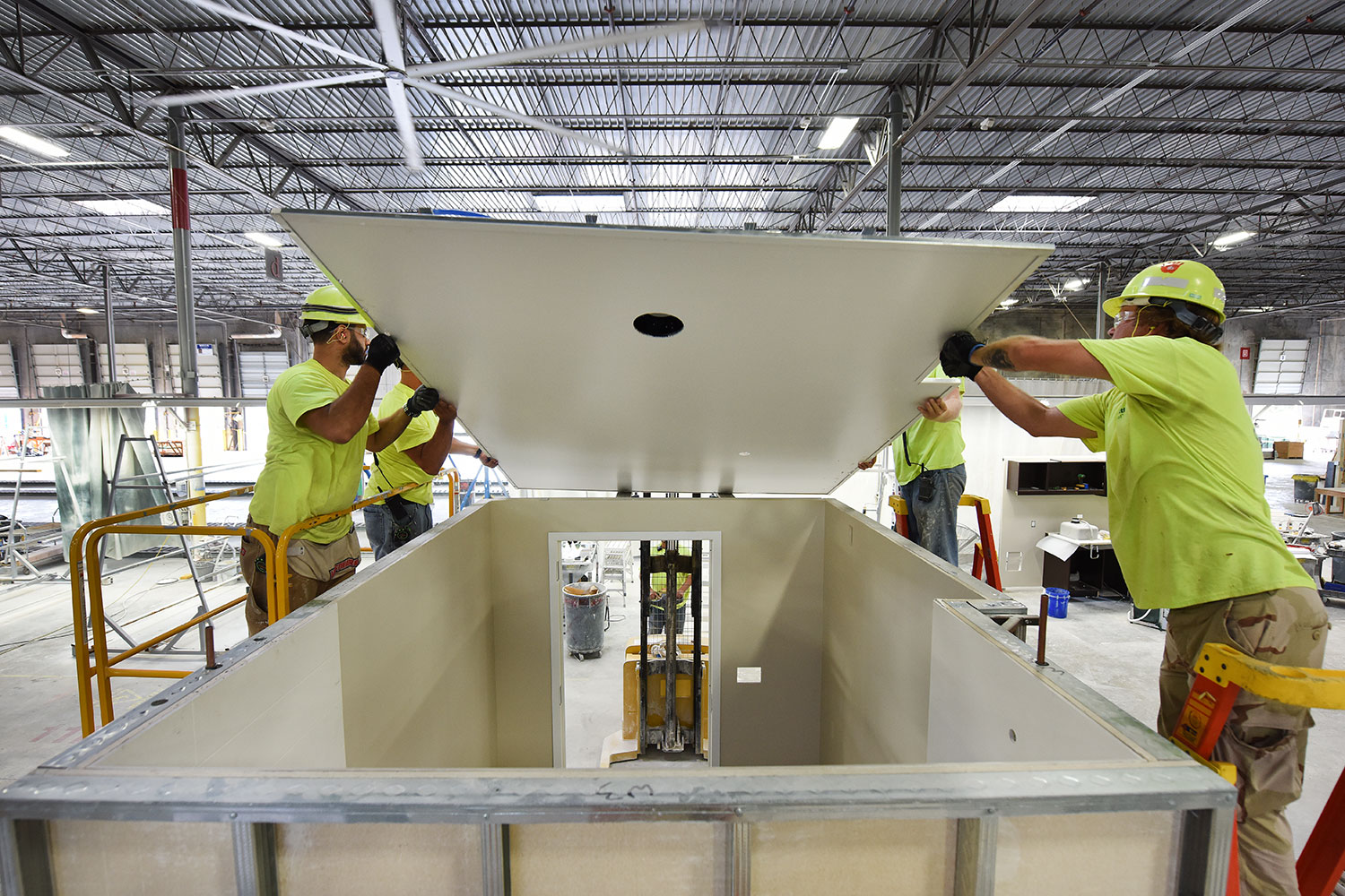 SurePods™ factory workers installing an IronCloud ceiling.
