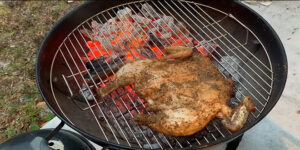 Indirect cooking keeps the hot coals from burning the meat while providing plenty of heat for cooking