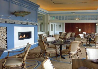 Sandpipers Restaurant set for dining with lighted fireplace