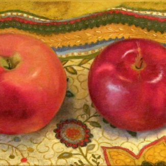 Oil painting by Joanna Strong of three apples and a bun on Indian fabric.