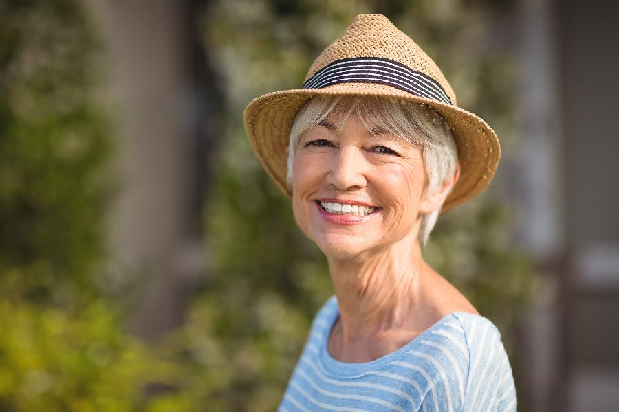 Portrait of a happy senior woman in straw hat
