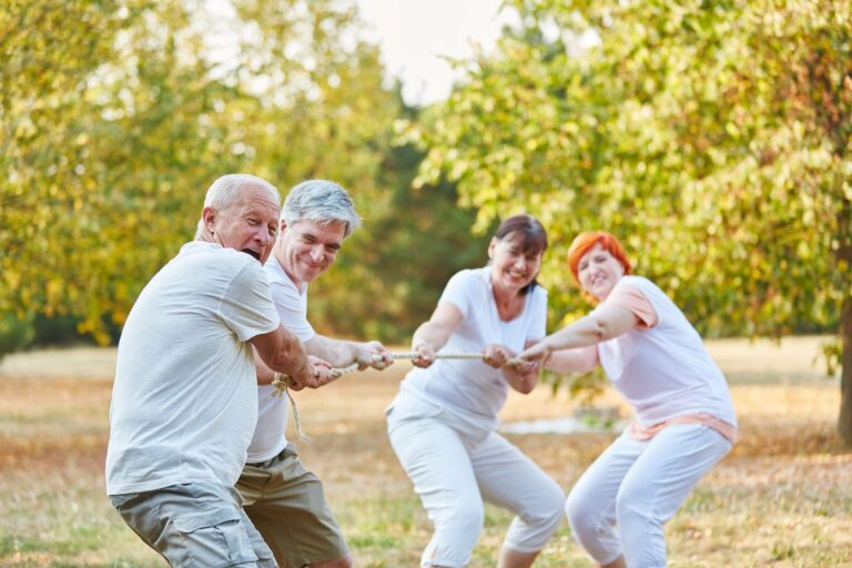 Tug of war competition with senior citizens in the park