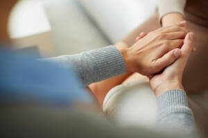 Hand embrace to represent Dialectical Behavior Therapy