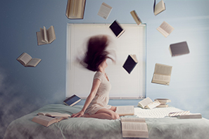 Woman throwing books to represent ADHD therapy