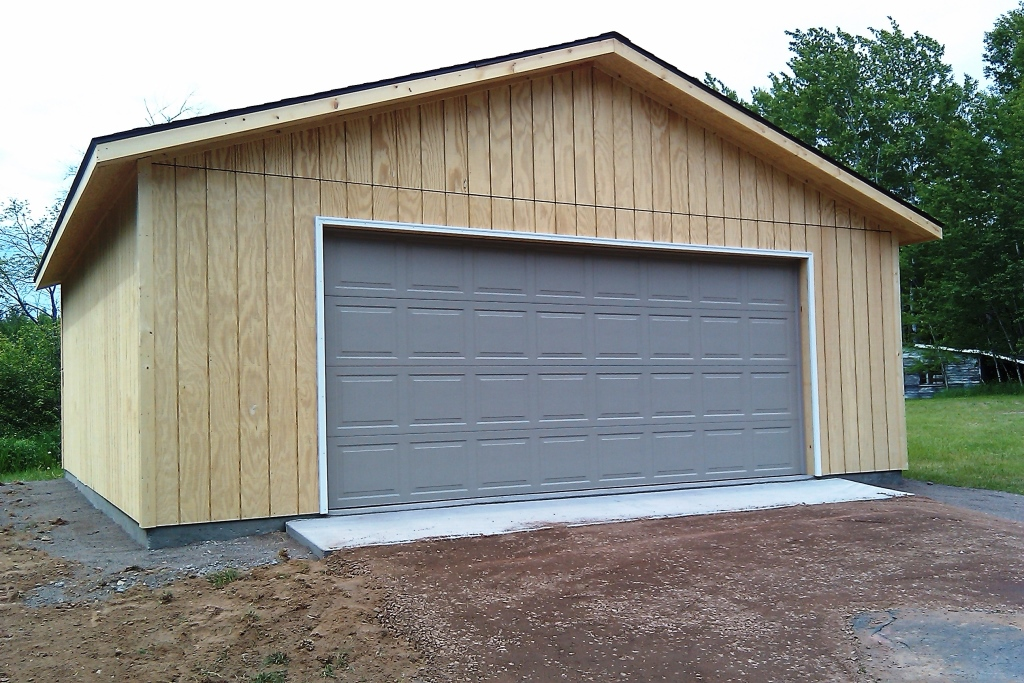 Unpainted T1-11 two car garage