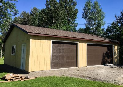 Upgrades Shown: 9′ x 8′ Garage Door - 4′ x 4′ Window - Aluminum Soffit and Fascia - 6/12 Pitch Roof - 9′ Wall