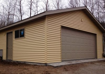 Upgrades Shown Concrete Apron Vinyl Siding Aluminum Soffit and Fascia Vented Block Prefinished Service Door