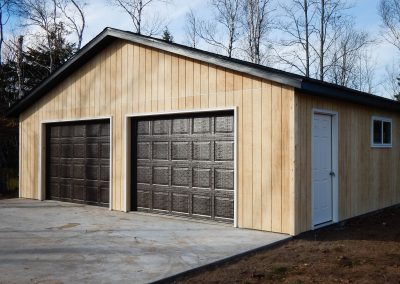 Upgrades Shown: 9′ x 7′ Garage Doors - Driveway - Aluminum Soffit and Fascia