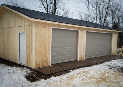 Upgrades Shown: Reverse Gable Style -  9′ x 8′ Garage Door - 16′ x 8′ Garage Door - 9′ Walls - Concrete Apron