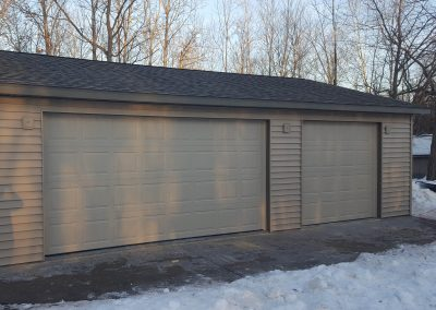 Upgrades Shown: 3 J-Blocks - Additional 9′ x 7′ Garage Door - Vinyl Siding - Concrete Apron - Aluminum Soffit and Fascia