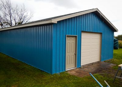 Upgrades Shown: Agricultural Steel Siding - Prefinished Service Door - 9′ x 8′ Garage Door - 10′ Wall - Aluminum Soffit and Fascia