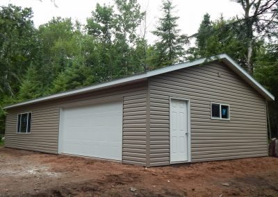 Upgrades Shown: Dutchlap Vinyl Siding - Window Upgrade - Aluminum Soffit and Fascia - J-Block - Prefinished Service Doors