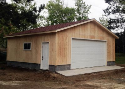 Upgrades Shown 2 Courses of Block Concrete Apron 16′ x 8′ Garage Door