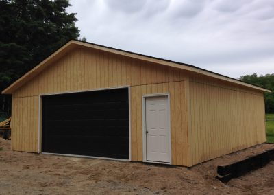 Upgrades Shown: 16′ x 8′ Garage Door - 9′ Wall