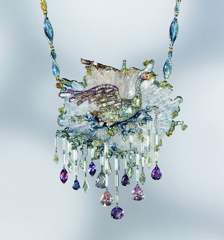 Le Cygne necklace by Wallace Chan is a mystical scene captured in a range of precious materials including fancy coloured diamonds, sapphires and crystal. The natural crystal represents the water disturbed by the swan as it spreads its wings. The swan's body is titanium in which three diamonds are embedded, and underneath three diamonds smaller