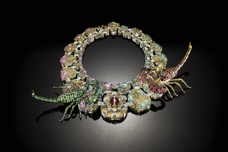 Eyes of Infinity parure composed of a necklace, ring and two brooches featuring two scorpions magnificently embellished with precious gem stones. The central stone is 45 carat alexandrite with a cat's eye effect. Rubies, demantoid garnets, diamonds and a yellow sapphire create the rich spectacle.
