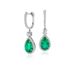 Pear Shape Emerald and Diamond Drop Earrings in 18k White and Yellow Gold (3.86 ct) (10.6x7mm)     Graceful and sophisticated, these dramatic drop earrings feature stunning, vibrant emeralds set in 18k white and yellow gold, ideal for special occasions. Purchase is accompanied by gemstone certification.
