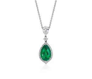 Pear-Shape Emerald and Pavé Halo Diamond Drop Pendant in 18k White Gold (2.71 carats)     Exquisite elegance, this one-of-a-kind gemstone and drop diamond pendant showcases a vibrant 2.71 carat emerald surrounded by pavé-set diamonds set in 18k white gold with a matching cable chain necklace. Emerald accompanied by gemstone report.