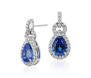 Pear Shape Tanzanite and Diamond Link Earrings in 18k White Gold (6.68 ct tw) (11x8mm)     The brilliance of color is captured in these tanzanite and diamond earrings featuring vibrant pear shape tanzanite gemstones framed by round diamonds in 18k white gold.