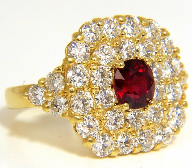 "Cluster Sparkles Mastered. 1.47ct. Natural GIA ""No Heat"" Ruby Diamonds ring. Ruby, Excellent clean clarity vivid red color. Brilliant sparkles from all angles Pristine Transperency GIA Certified (Report Attached) 3.32ct side diamonds Vs-2 Clarity, F/G-color 18kt. yellow gold 13.5 grams. Deck of ring: .71 X .72 Inch. depth of ring: .32 inch current ring."
