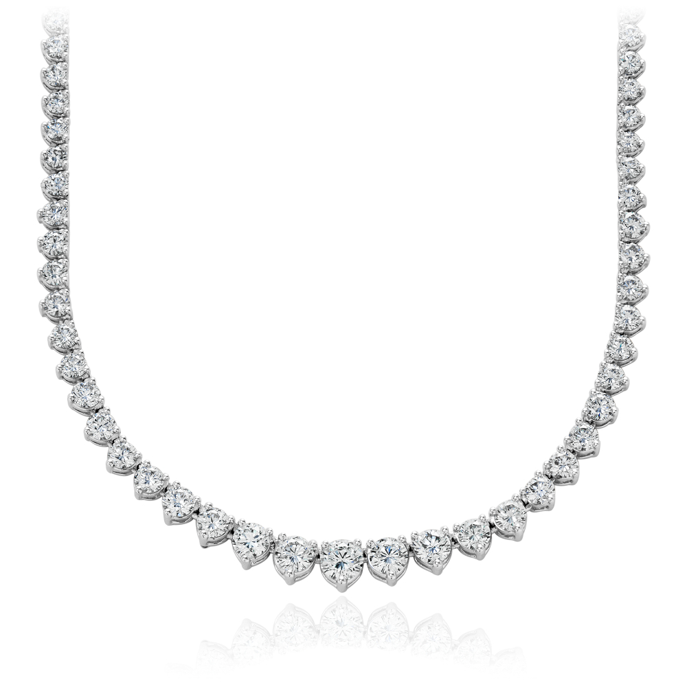 Eternity Diamond Necklace in 18k White Gold (10 ct. tw.) Exceptional radiance, this diamond necklace features 115 graduated brilliant cut round diamonds hand-set in 18k white gold for maximum fire. 10 carat total diamond weight.