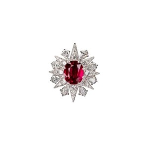 Constel ruby ring from Star Diamond Private Jeweller. The vivid red Mozambique ruby is set within a sunburst of pear- and round-cut white diamonds.