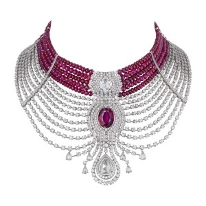 Cartier Reine Makéda necklace in platinum, set with a 15.29 carat oval-shaped ruby from Mozambique, alongside rose-cut and pear-shaped diamonds, and cabochon-cut ruby beads. The ruby choker can be detached and worn separately from the diamond necklace.