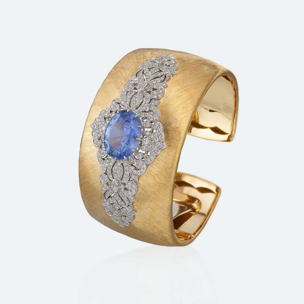Yellow and white gold with sapphire and diamonds