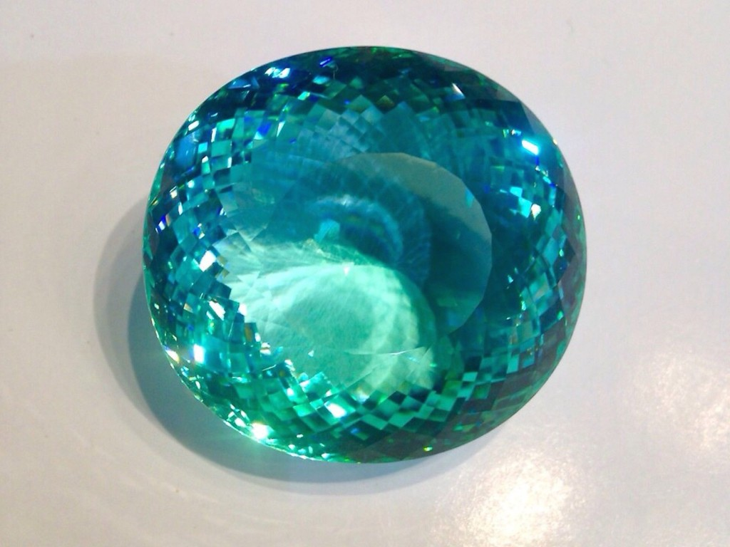 GIA Certified copper bearing Paraiba Tourmaline and the largest known specimen in the world at 267.25 carats. GIA Certified and stunning. Near flawless example and coloring is incredible.