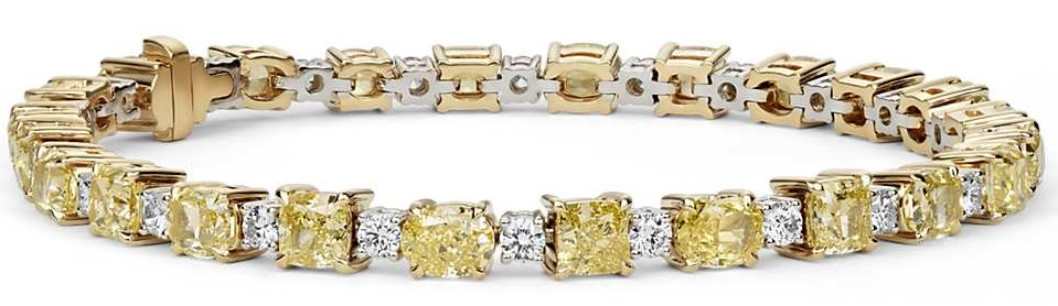 Fancy Intense Yellow Radiant & Cushion Diamond Bracelet in 18k Yellow Gold Unmatched in brilliance, this one-of-a-kind diamond bracelet has twenty-four radiant and cushioned diamonds set in enduring yellow gold, a stunning accent to any ensemble.