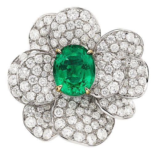 Estate Emerald, Diamond and White Gold Ring with an oval-shaped emerald