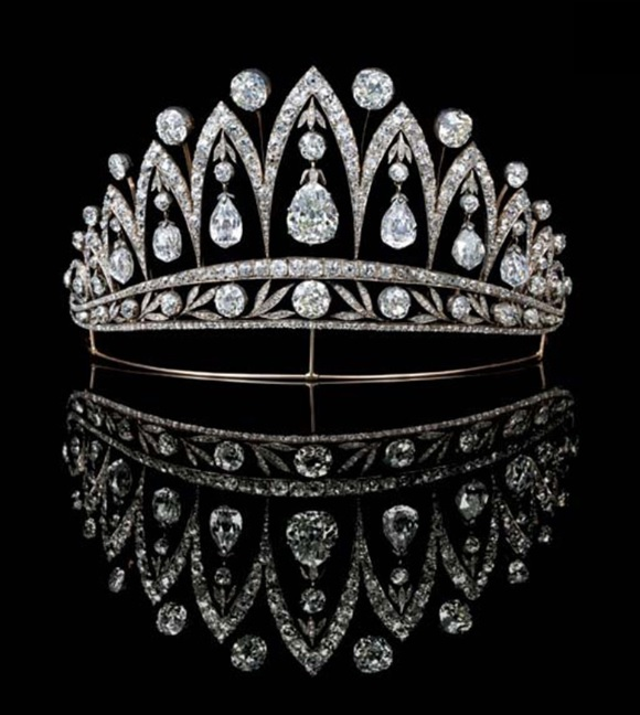 A magnificent antique diamond tiara, by Fabergé. Designed as a series of graduated old-cut diamond arches with knife-edge collet spacers, the central pear-shaped diamond flanked by three briolette and one old-cut diamond, each with diamond collet and leaf surmount to the foliate band, on gold wire frame, mounted in silver and gold, circa 1890, 13.2 cm wide, with Russian assay marks for gold. Sold for £1,050,400 on 13 June 2007 at Christie's in London