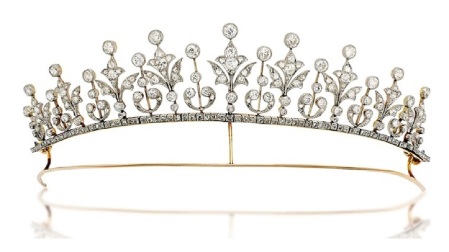An early-20th-century diamond tiara / necklace. Composed of a graduated series of rose and old-cut diamond millegrain-set foliate motifs alternately set between diamond collet accents raised on knifebar connections, with rose-cut diamond line below and similarly-set detachable backchain, mounted in platinum and gold, circa 1900. As a necklace 37 cm long, original case. Sold for £15,000 on 27 November 2013 at Christie's in London